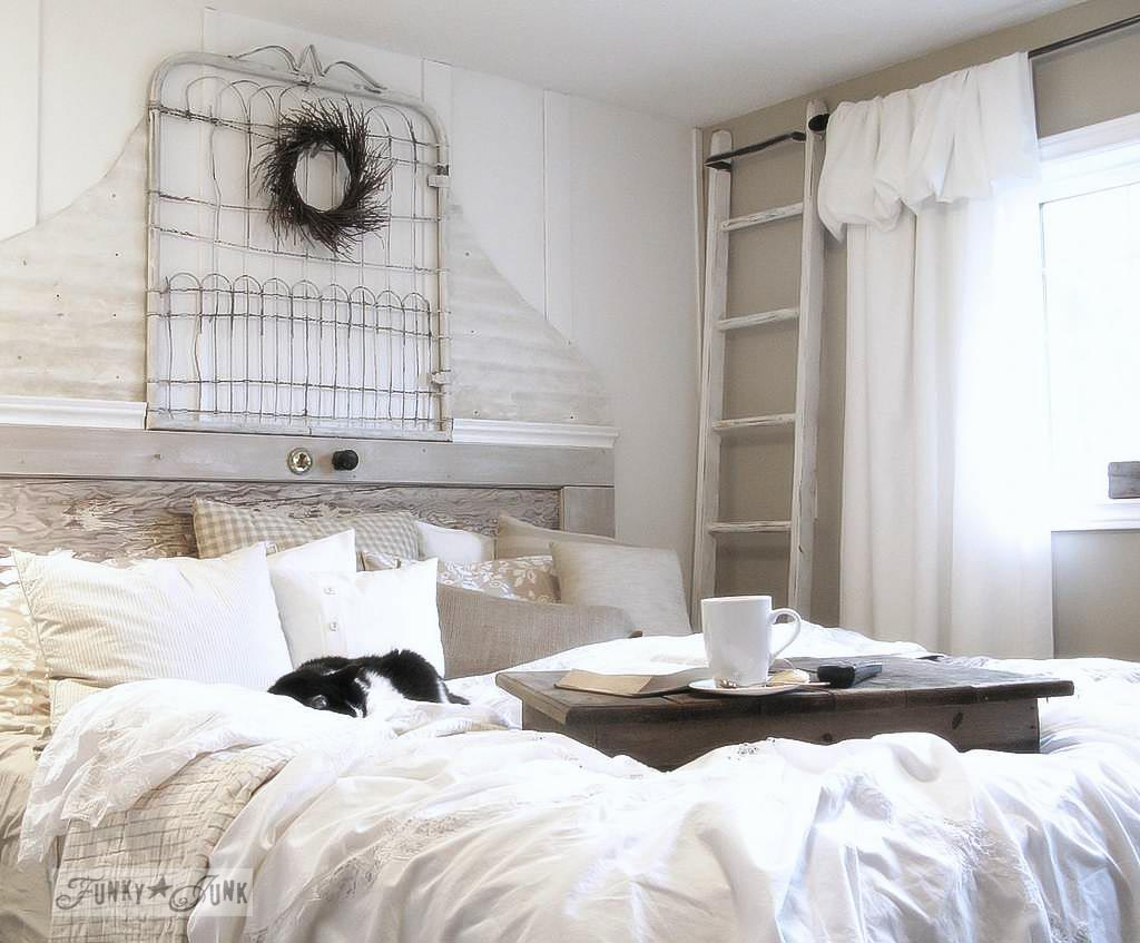 A salvaged White Trash bedroom makeover with old door and gate headboard, via FunkyJunkInteriors.net