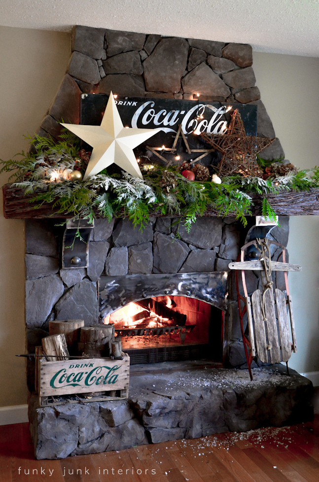 A Coca Cola inspired Christmas mantel on cultured stone fireplace, via Funky Junk Interiors