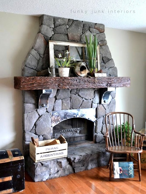 Faux spring mantel decorating that never wilts, on a cultured stone fireplace via Funky Junk Interiors
