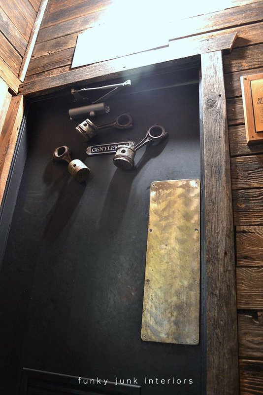 Machinery parts decorate the men's washroom door. Welcome to a full blown tour of the inside of Mission Springs Brewing Company, a junk-filled pub and restaurant filled with antiques and salvage architecture you will not believe!