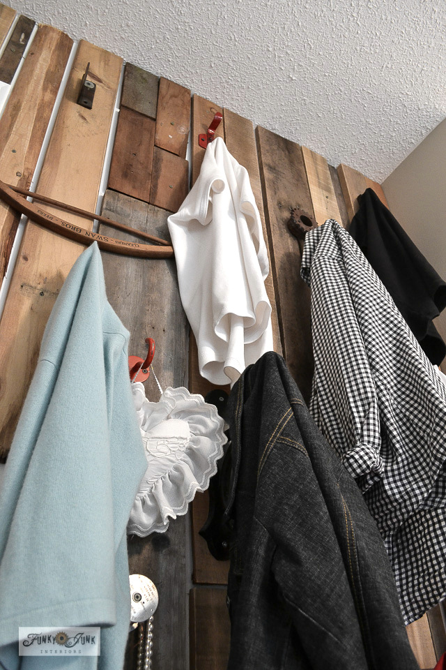 Learn how to build an easy rustic and productive pallet wood closet wall to hang up more clothes! Makes a beautiful feature wall too! With plenty of unique salvaged clothing hook ideas! Read full tutorial.