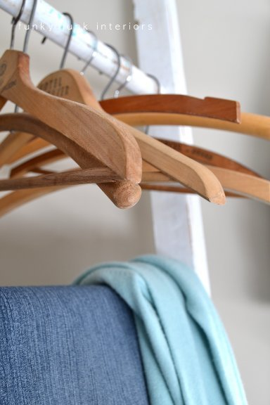 Build a ladder clothing hanger changing area in a master bedroom!