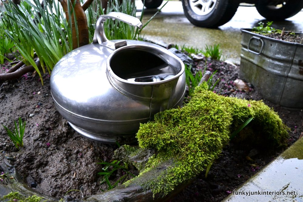 Teddy's moss branch in the garden via Funky Junk Interiors