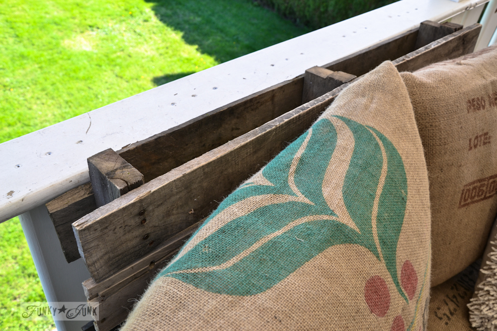 Learn how to build an easy and comfy pallet wood chair in just a couple of hours! Perfect for outdoor furniture on a patio and styled in burlap bean sacks! Click to visit all the details and read the full tutorial.