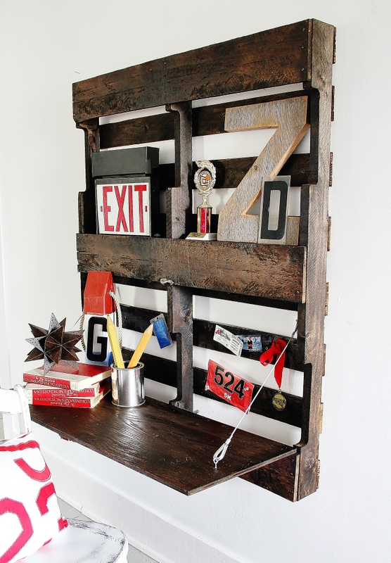 Folding pallet desk on a wall, by Thistlewood Farms