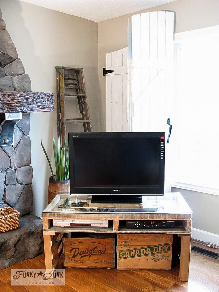 Gate styled window screens, and a pallet TV stand, via Funky Junk Interiors, part of a whole home JUNK tour.