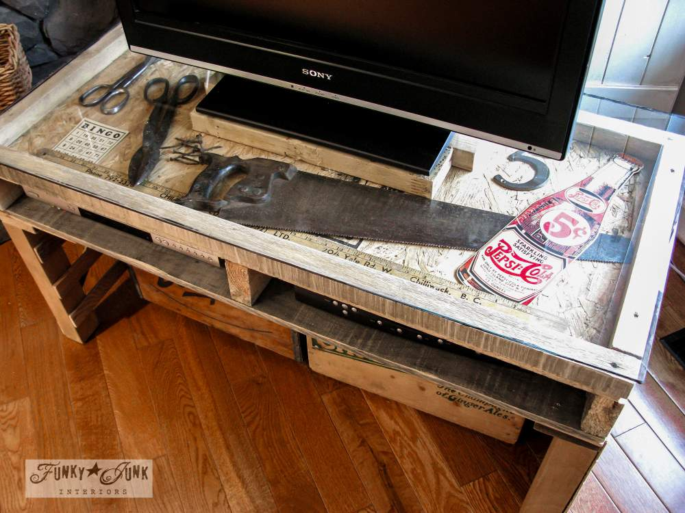 A pallet wood TV stand with a display showcase, via Funky Junk Interiors, part of a whole home JUNK tour
