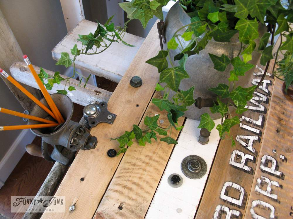 Pallet wood with signs for office desk, meat grinder for pen holder, via Funky Junk Interiors