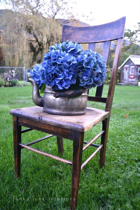 flowers in creative junk vases - blue hydrangeas in old kettle