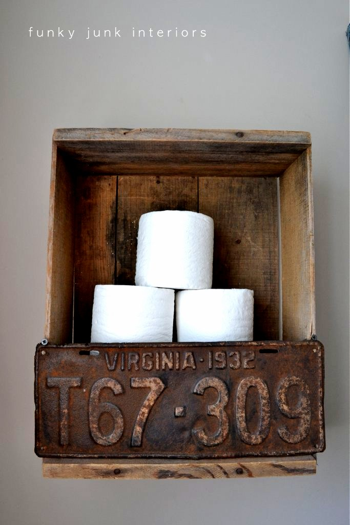 Crate and license plate toilet paper storage via https://www.funkyjunkinteriors.net/