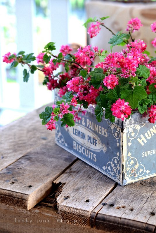 A gorgeous antique tin makes the best flower vase! Part of - Try these up-cycled finds as vases for unique flower arrangements!