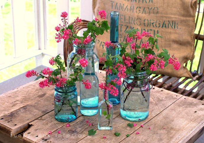Collect an assortment of blue mason jars and bottles for impact! Part of - Try these up-cycled finds as vases for unique flower arrangements!