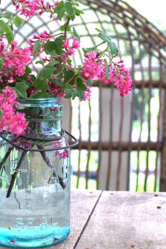 Blue mason jars and bottles make beautiful fresh flower vases! Part of - Try these up-cycled finds as vases for unique flower arrangements!