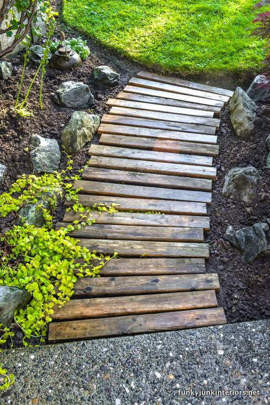 reclaimed wood walkway in a spring flowerbed
