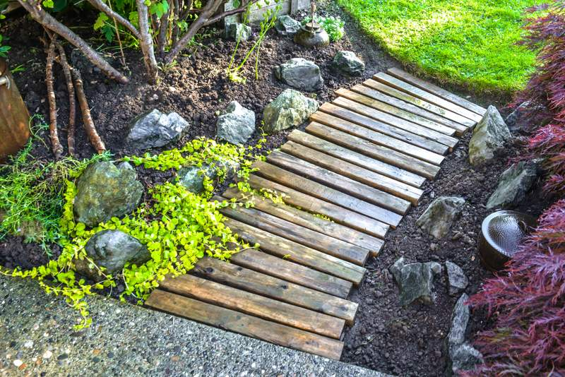pallet wood walkway via Funky Junk Interiors