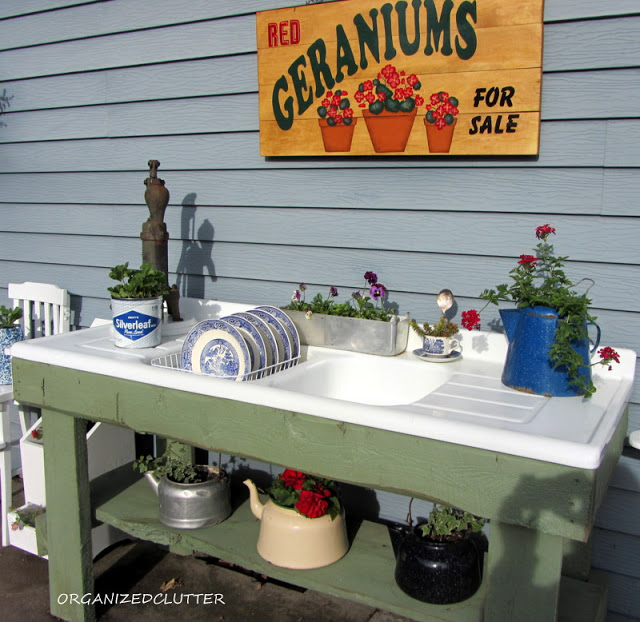 A whimsical outdoor kitchen potting bench, by Organized Clutter, featured on Funky Junk Interiors