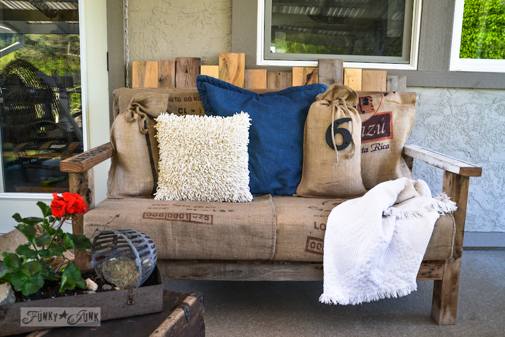 Pallet sofa with sandbag pillows via Funky Junk Interiors