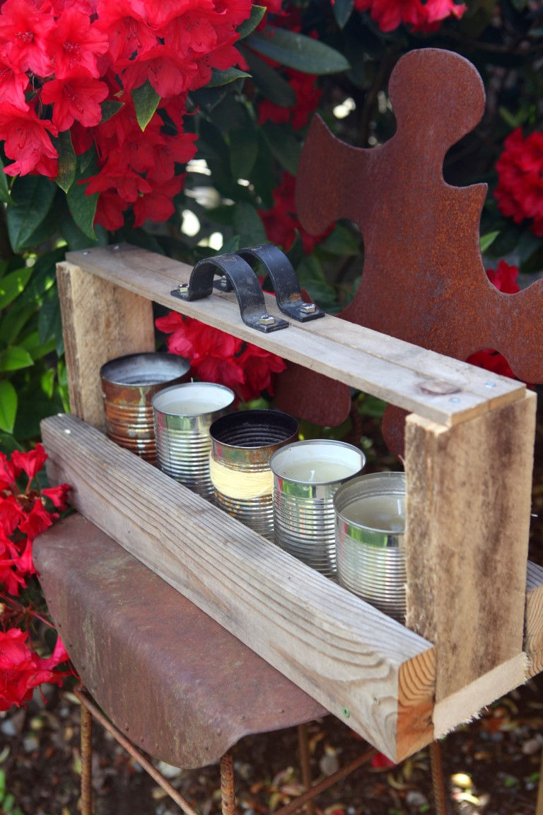 Reclaimed wood toolbox holding citronella candles via Garden Therapy
