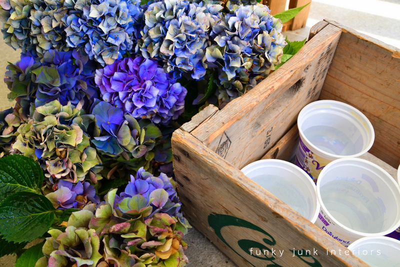 blue hydrangeas in a Dairyland crate via Funky Junk Interiors