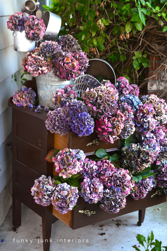 Use an old dresser to display a waterfall of hydrangea stems tucked inside each open drawer for amazing impact! Part of - Try these up-cycled finds as vases for unique flower arrangements!