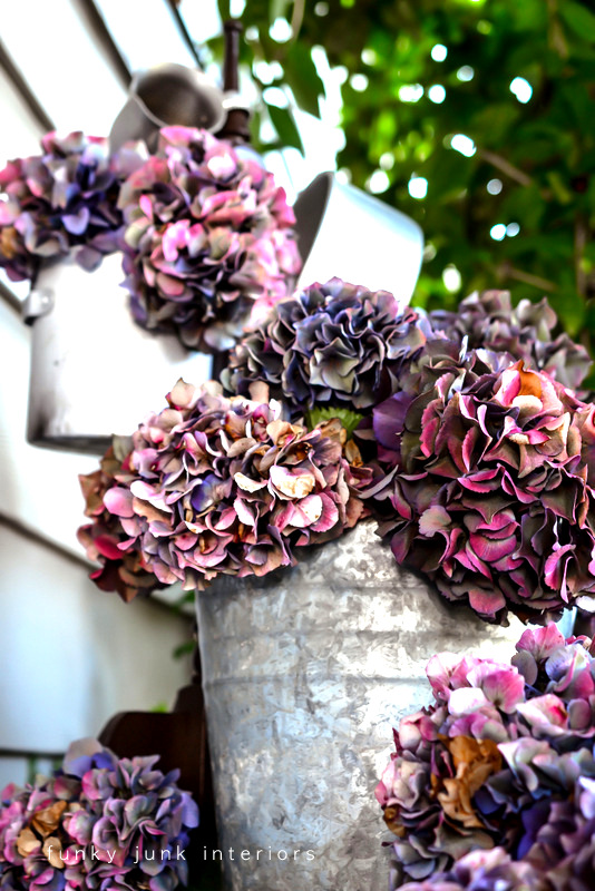 hydrangeas in junk vases via Funky Junk Interiors