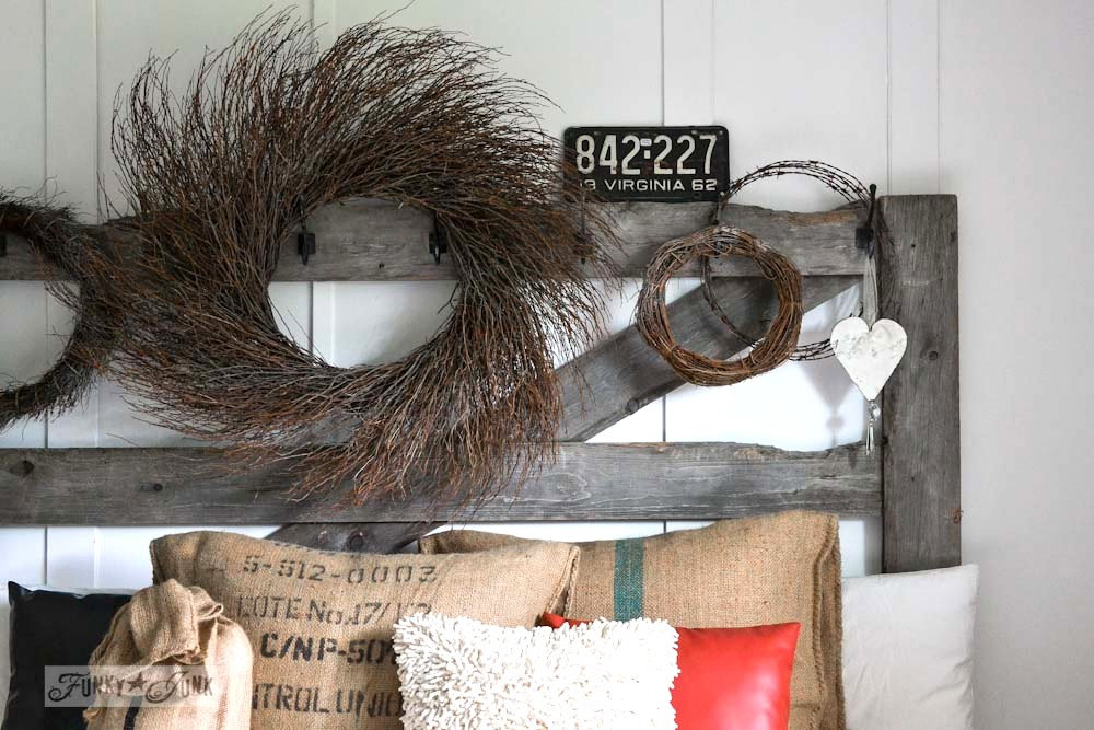 Rustic wreaths on a horse gate headboard in master bedroom via Funky Junk Interiors & A junk filled summer home decorating tour - Funky Junk ...