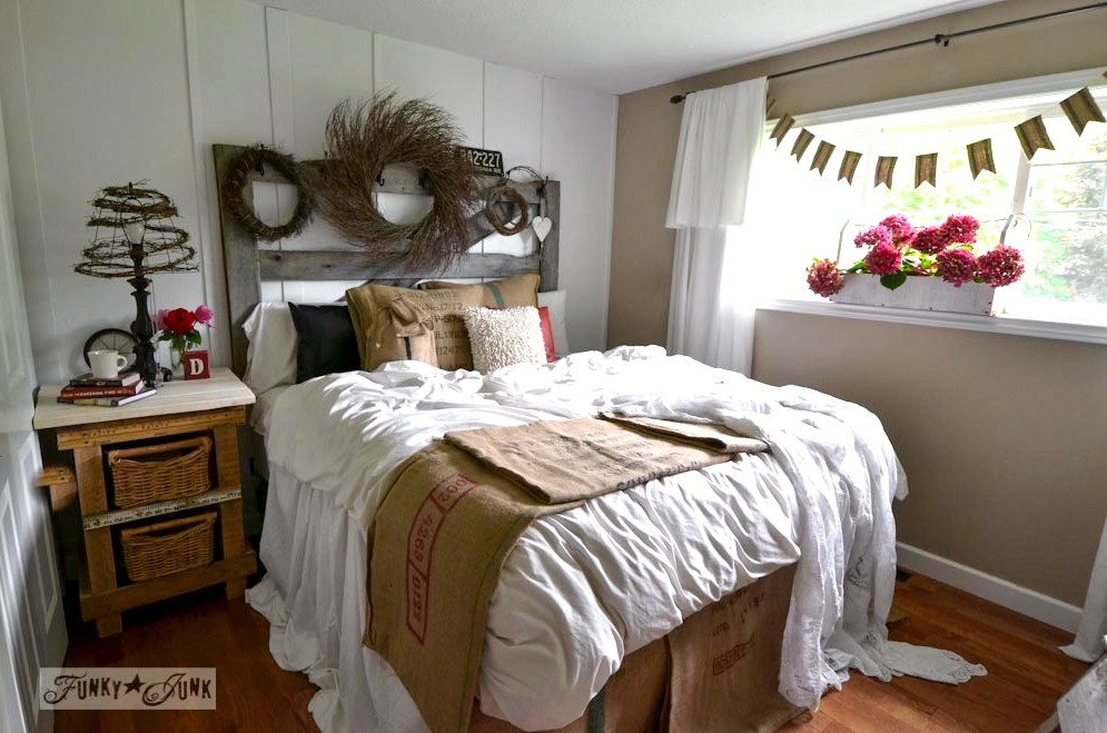 Master bedroom with old horsegate headboard and handmade night table from pallet wood via Funky Junk Interiors