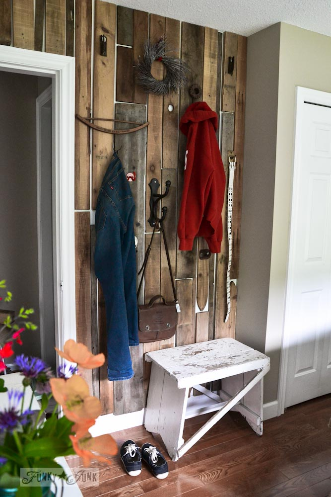 pallet closet wall in master bedroom for hanging clothes, via Funky Junk Interiors