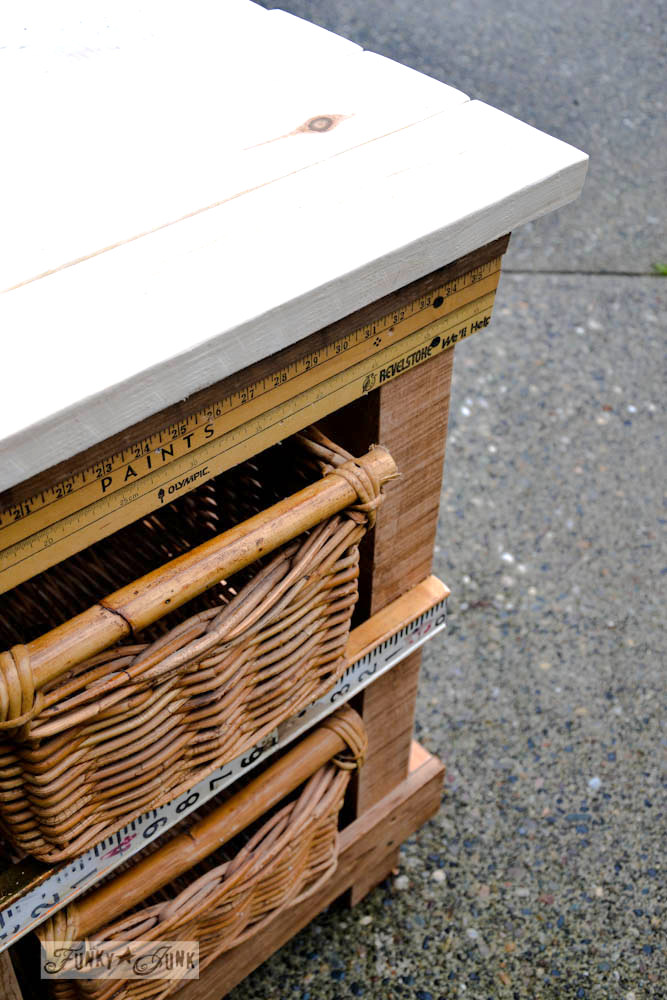 pallet wood night table with basket drawers and yardstick trim via Funky Junk Interiors