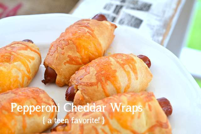 Pepperoni Cheddar Wraps - so delicious and easy for kids to make! Great for lunches or a picnic at the beach. via Funky Junk Interiors