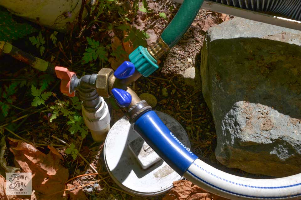 Tips for camping in a travel trailer - why a clear sewer hose adaptor is the bomb! / funkyjunkinteriors.net