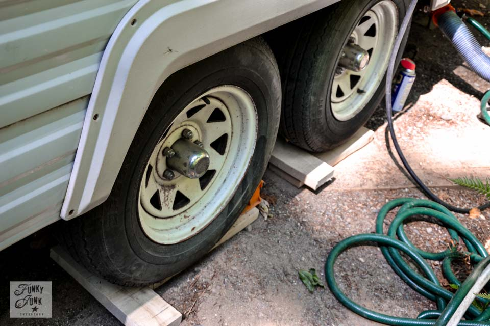 Tips for camping in a travel trailer - how to level trailer tires / funkyjunkinteriors.net