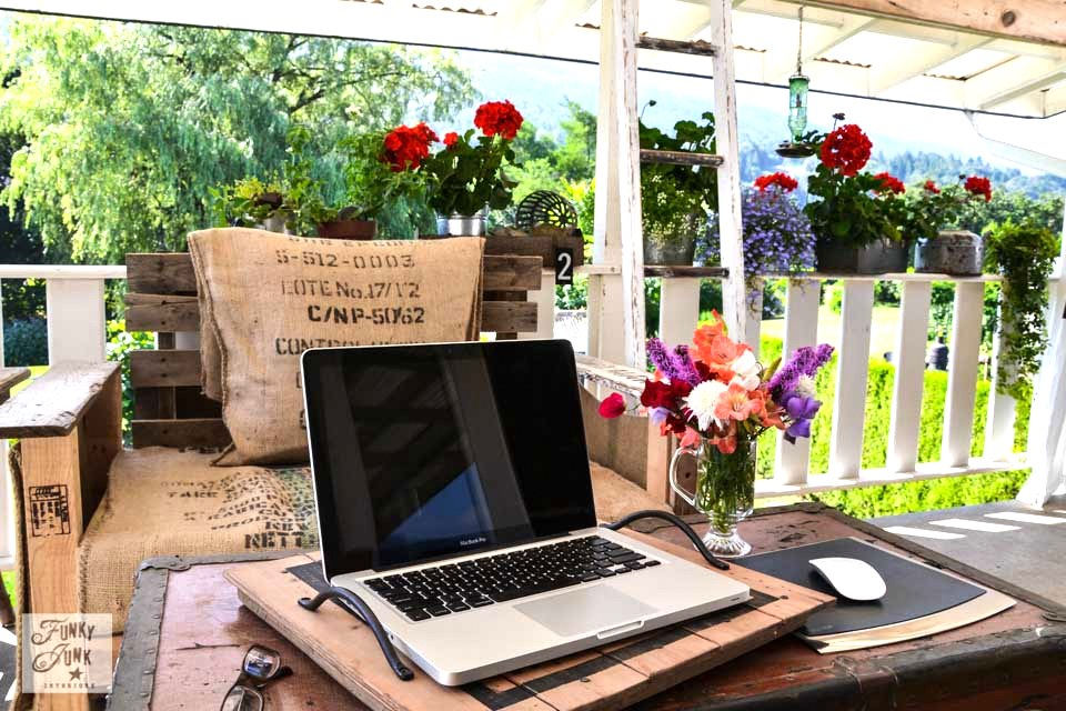 Junky flower garden filled outdoor patio office via https://www.funkyjunkinteriors.net/