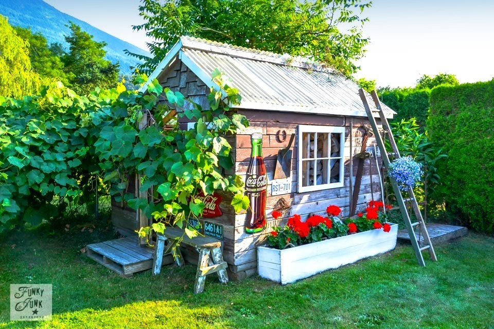 Rustic garden shed storing firewood via https://www.funkyjunkinteriors.net/