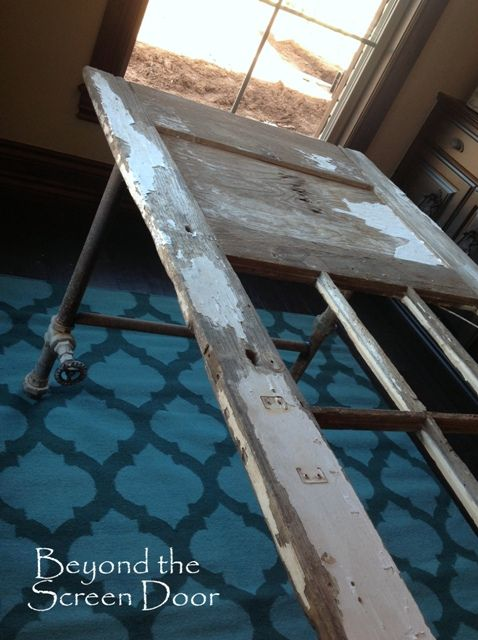 DIY old pipe and door table or desk by Beyond the Screen Door featured on Funky Junk Interiors