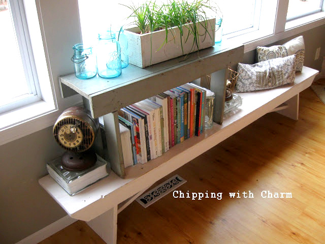 Benches to Book Shelf - Chipping with Charm - stacked vintage benches as a side table featured on Funky Junk Interiors