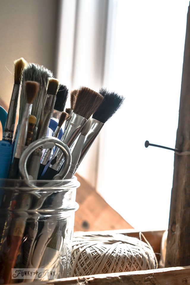 Mason jar storage for paint brushes and wooden box for string, part of a junky decorating office redo, via Funky Junk Interiors