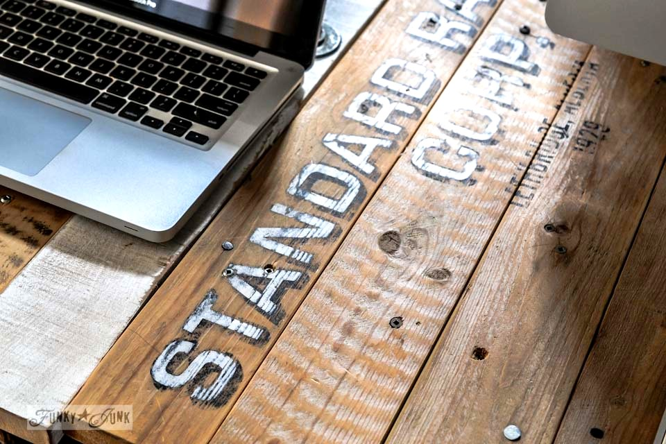 Old sign looking pallet wood desk top, part of a junk decorating office redo, via Funky Junk Interiors