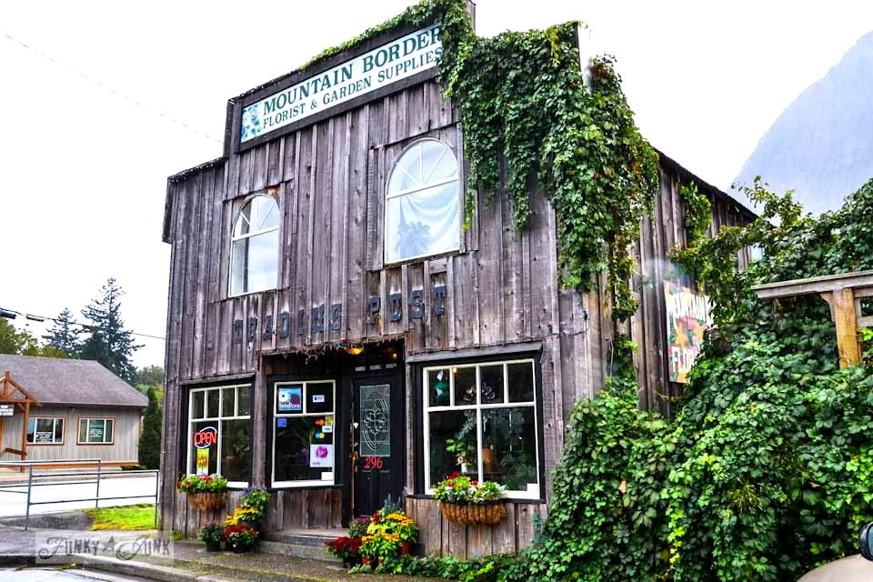 Board and batten barn wood siding with vines / Reclaimed garden features at a Hope garden centre via https://www.funkyjunkinteriors.net/