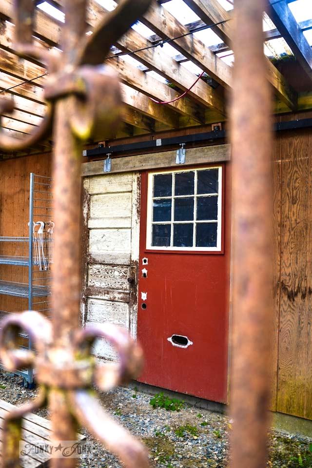 Two reclaimed doors for a barn sliding door  / Reclaimed garden features at a Hope garden centre via https://www.funkyjunkinteriors.net/