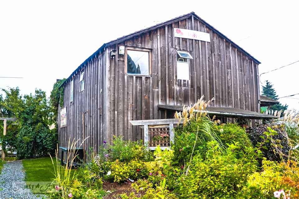 Board and batten barn wood siding  / Reclaimed garden features at a Hope garden centre via https://www.funkyjunkinteriors.net/