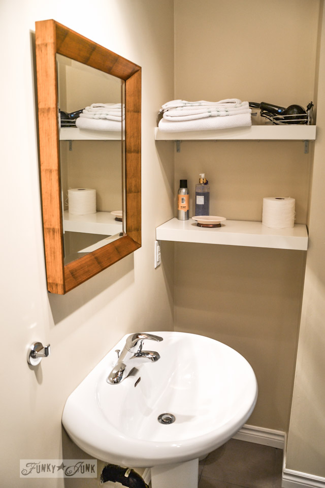 Pedestal sink with shelves in a bathroom / part of A Little R and R in a Bed and Breakfast via https://www.funkyjunkinteriors.net/