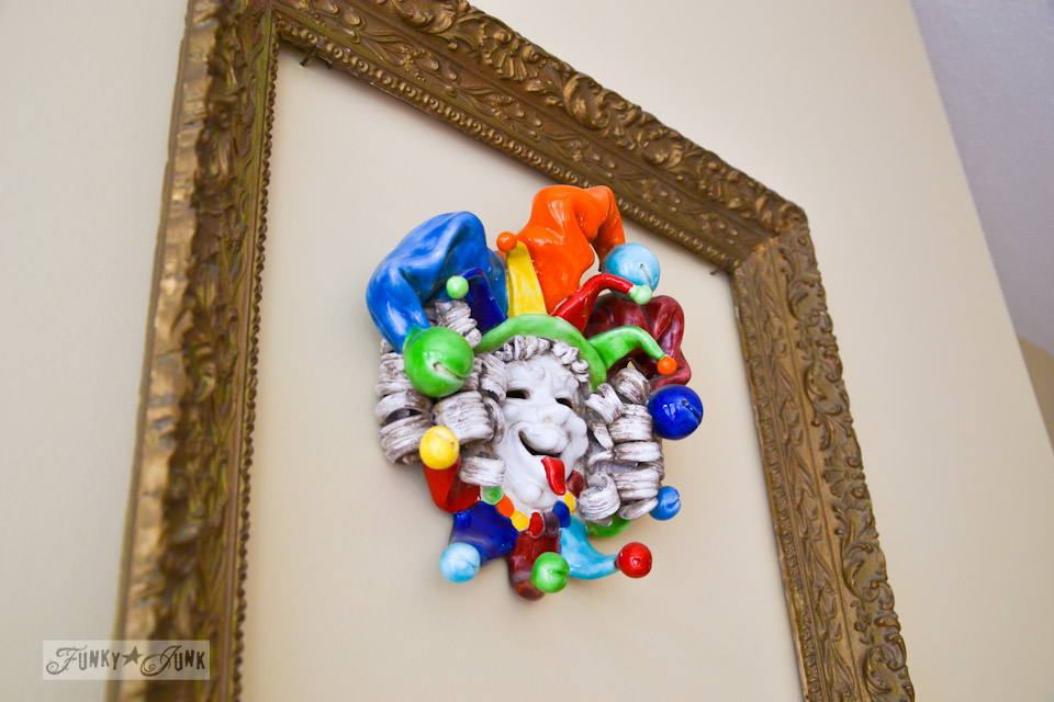 Glass colourful joker inside gold picture frame / part of A Little R and R in a Bed and Breakfast via https://www.funkyjunkinteriors.net/