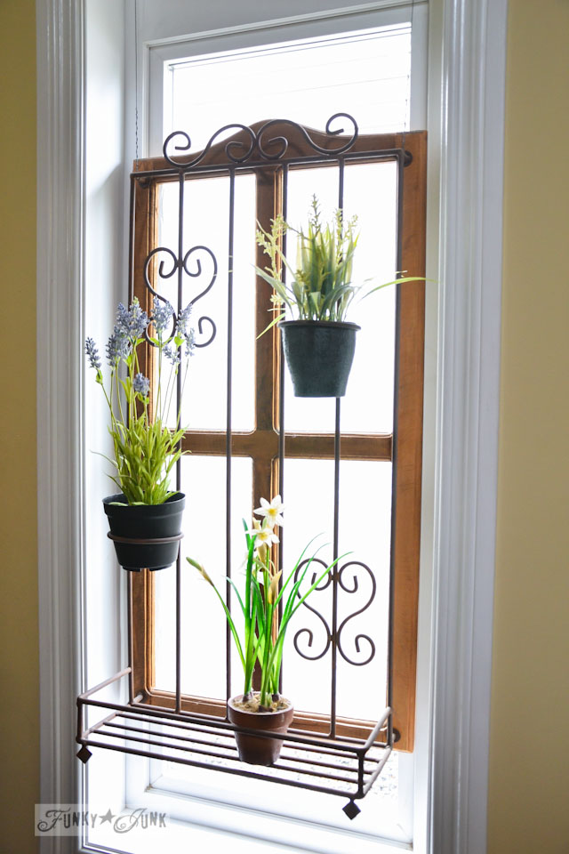 Privacy window treatment of an old window with a plant stand attached / part of A Little R and R in a Bed and Breakfast via https://www.funkyjunkinteriors.net/