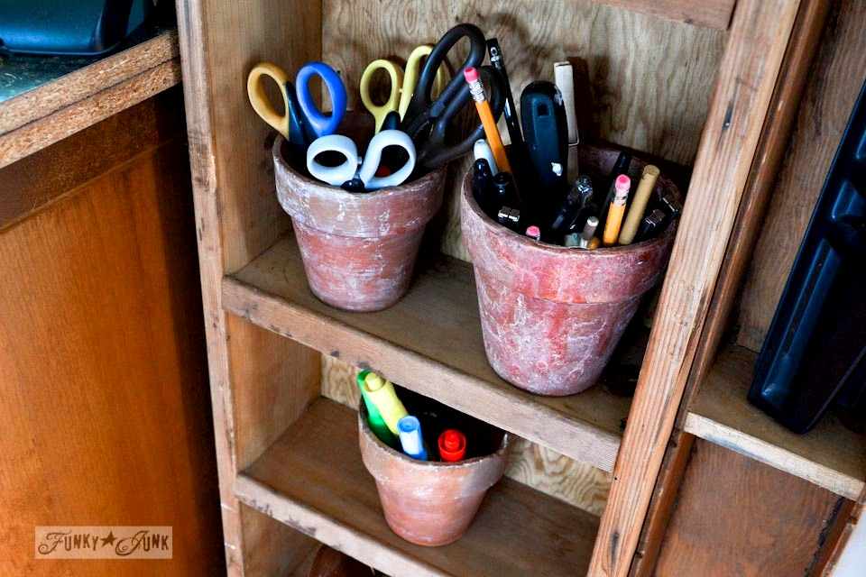 Clay pot pencil holders / Crazy old crates on a wall phone station for office supplies via https://www.funkyjunkinteriors.net/