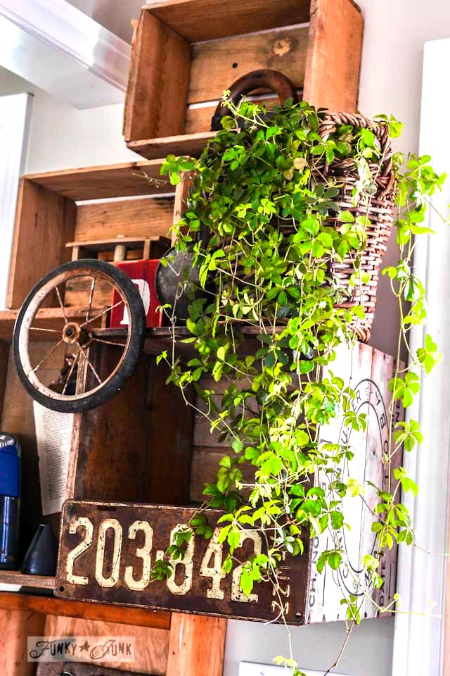 Stacked crates, plant and junk on a wall, part of / Crazy old crates on a wall phone station for office supplies via https://www.funkyjunkinteriors.net/