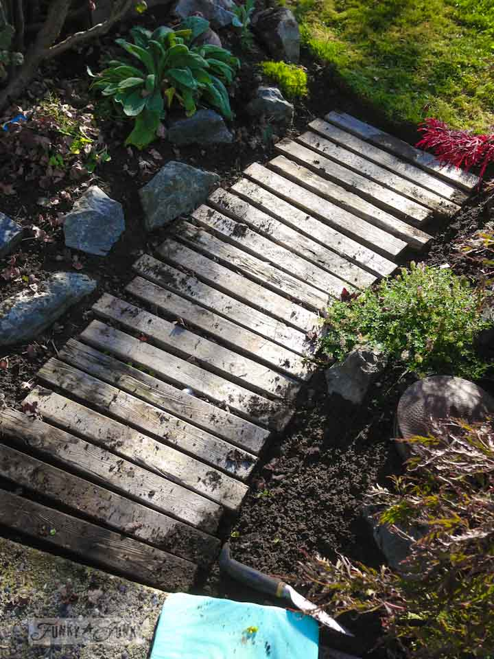 Pallet walkway gets weeded during a garden gone wild therapy session via  https://www.funkyjunkinteriors.net/