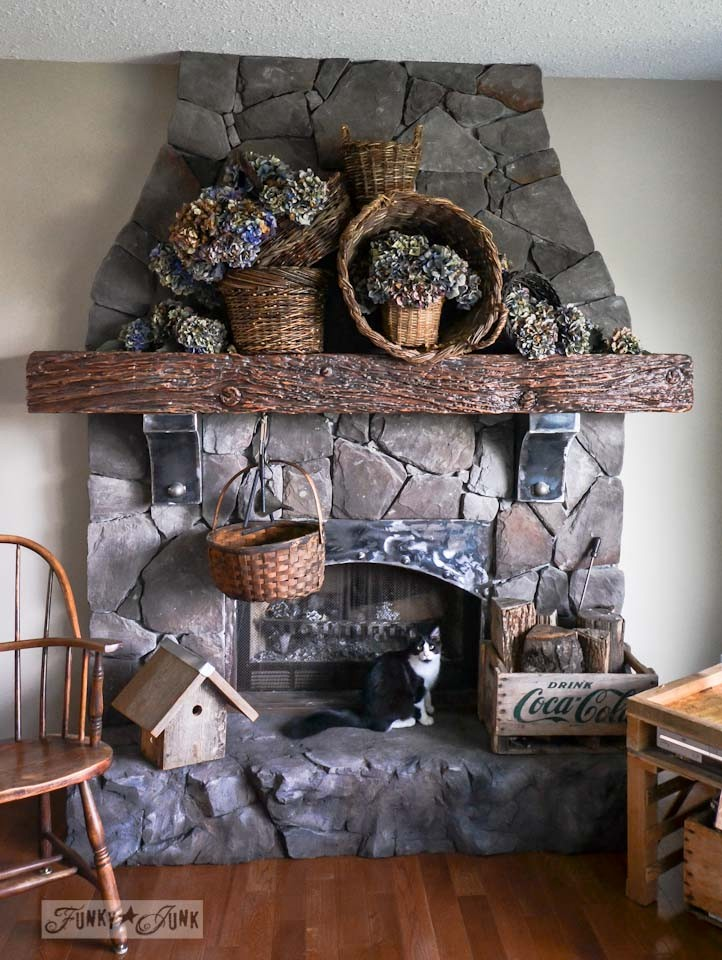 A waterfall of dried hydrangeas in baskets fall mantel decorating by https://www.funkyjunkinteriors.net/