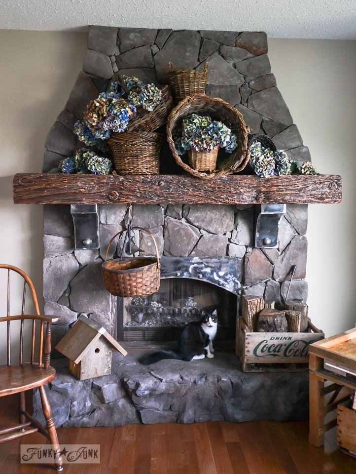 Waterfall of hydrangea filled rustic baskets for a fall mantel, via Funky Junk Interiors