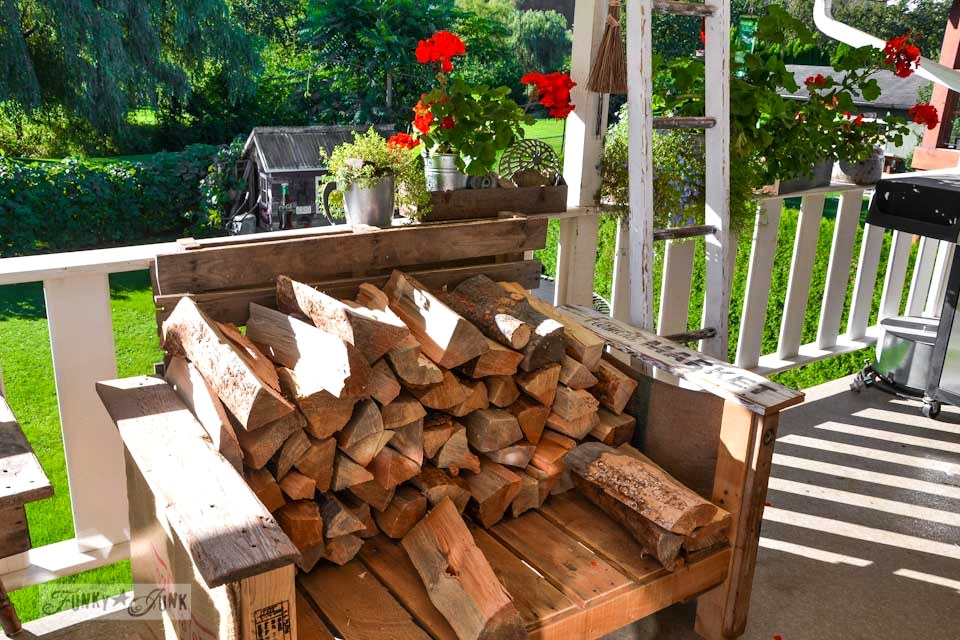 Stacked firewood on a pallet wood chair, part of The first cozy fireplace fire of the season via https://www.funkyjunkinteriors.net/